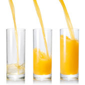 Pouring orange juice into the glass — Stock Photo