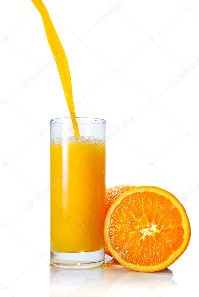 Orange juice poring into glass isolated on white  Stock Photo #3004014