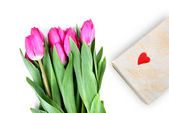 Close-up pink tulips with gift isolated on white — Stock Photo