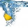 Fresh lemon dropped into water with bubb — Stok fotoğraf