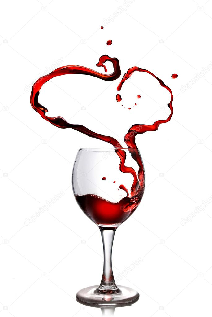 Heart from pouring red wine in goblet isolated on white — Stock Photo #3030784