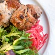 Stock Photo: Shashlik with potherbs on plate