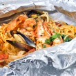 Royalty-Free Stock Photo: Pasta with oysters and tomato in foil