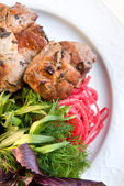 Shashlik with potherbs on the plate — Stock Photo