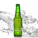Green beer bottle with water splash — Stock Photo #3172487