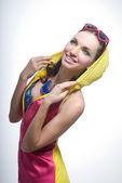 красивая молодая женщина в одежде цвета на белом фоне — Стоковое фото