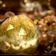 Foto Stock: Halloween pumpkin with smoke