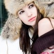 Winter portrait of young woman in fur hat — Stock Photo #3374188