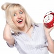Shocked beautiful young woman with alarm clock — Stock Photo