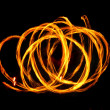 Fire circles on black — Stock Photo