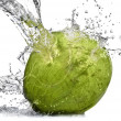 Stock Photo: Green coconut with water splash