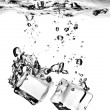Ice cubes dropped into water with splash — Stock Photo #3379526