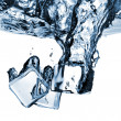 Ice cubes dropped into water with splash — Foto de Stock
