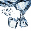Ice cubes dropped into water with splash — Stockfoto