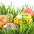 Color easter eggs in nest from green grass — Stock Photo #3379602