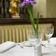 Served table in restaurant with flower — Stock Photo