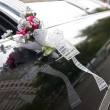 Door of black wedding car with flower and ribbon — Stock Photo