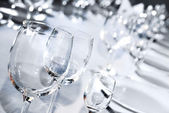 Glass goblets on white table — Stock Photo