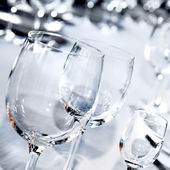 Three glass goblets on white table — Stock Photo