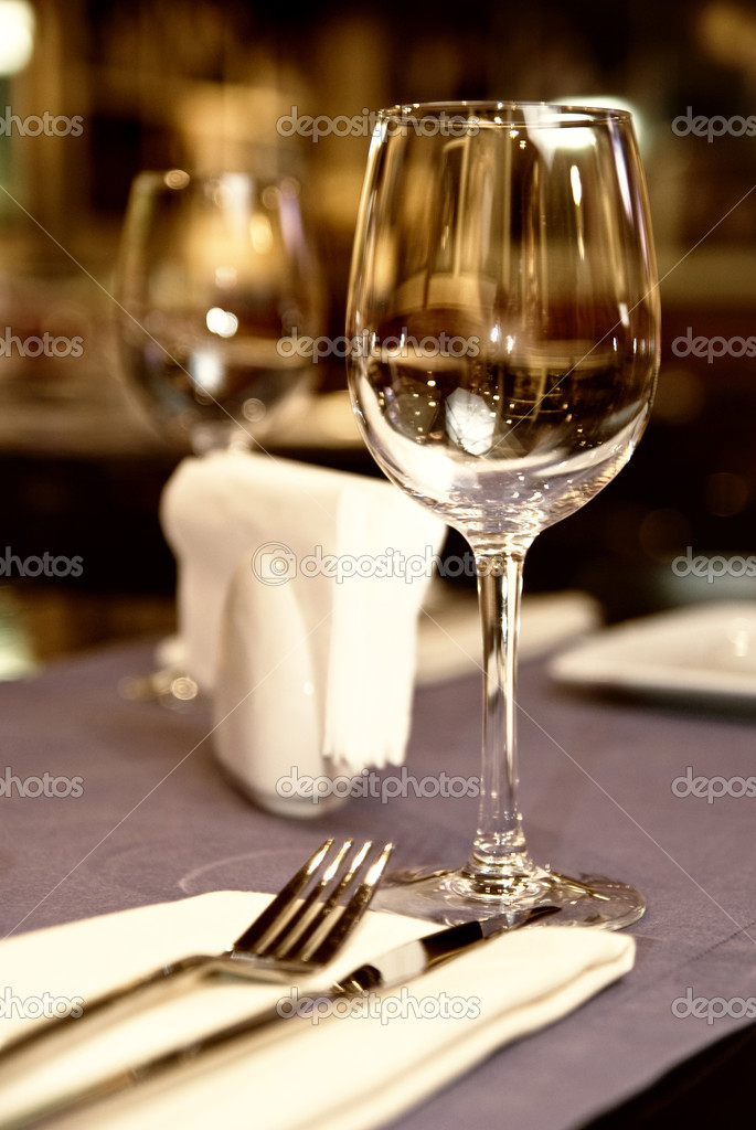 Wineglass on served table in restaurant — Stock Photo #3379745