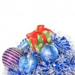 Christmas balls with and gift with decoration - Stock Photo
