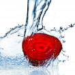 Red beet with water splash — Stok fotoğraf