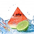 Watermelon with lime and water splash — Stok fotoğraf