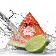 Water splash on watermelon and green lime — Foto de Stock