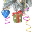 Christmas ball, gift and decoration on fir tree branch — ストック写真