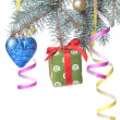 Christmas ball, gift and decoration on fir tree branch — Stock Photo