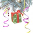 Christmas gift and decoration on fir tree branch — Stok fotoğraf