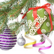 Christmas balls, gift and decoration on fir tree branch - Foto Stock