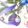 Christmas balls, gift and decoration on fir tree branch  — Стоковая фотография