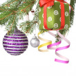 Christmas balls, gift and decoration on fir tree branch — Stock Photo #3381245