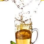Fresh lemon juice and tea cup — Stock Photo