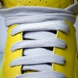 Close-up laces on the yellow boots — Stock Photo