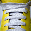 Stock Photo: Close-up laces on yellow boots