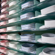 Shelf with shirts in store — Stok fotoğraf