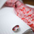 Close-up photo of stud on white shirt with red tie — Stock Photo #3384431