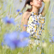 Girl in field of flowers — Stock Photo