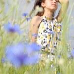 Girl in field of flowers — Stock Photo