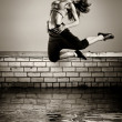 Girl jumping on the roof — Stock Photo