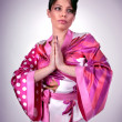 Atrractive girl in kimono pray - Photo