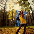 Woman in blue jaket in autumn park — Stock Photo