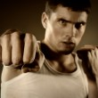 Portrait of the hitting fighter — Stock Photo #3384772