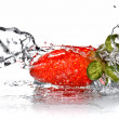Fresh strawberry and water splash isolated on white — Stock Photo