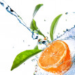 Stock Photo: Water drops on orange with green leaves isolated on white