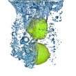 Fresh lime dropped into water with bubbles isolated on white — Zdjęcie stockowe