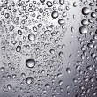 Stock Photo: Drops of water on glass