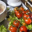 Cluse up english breakfast with tomato in focus - Stock Photo